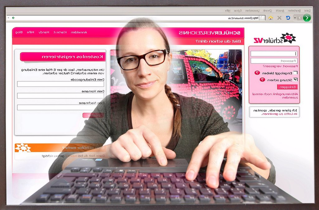 Young woman sitting at a computer surfing the Internet, viewing a page of StudiVZ, a social network for students, view from within the computer, symbolic image : Stock Photo