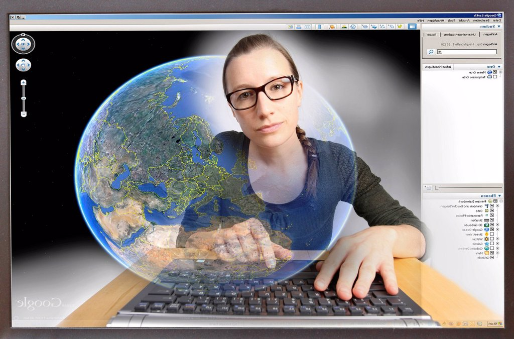 Stock Photo: 1848-608486 Young woman sitting at a computer surfing the Internet, viewing Google Earth, view from within the computer, symbolic image