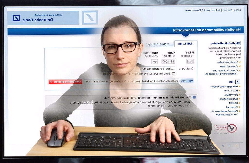 Stock Photo: 1848-608487 Young woman sitting at a computer surfing the Internet, viewing an Internet banking page, Deutsche Bank, logging into her online account, view from within the computer, symbolic image