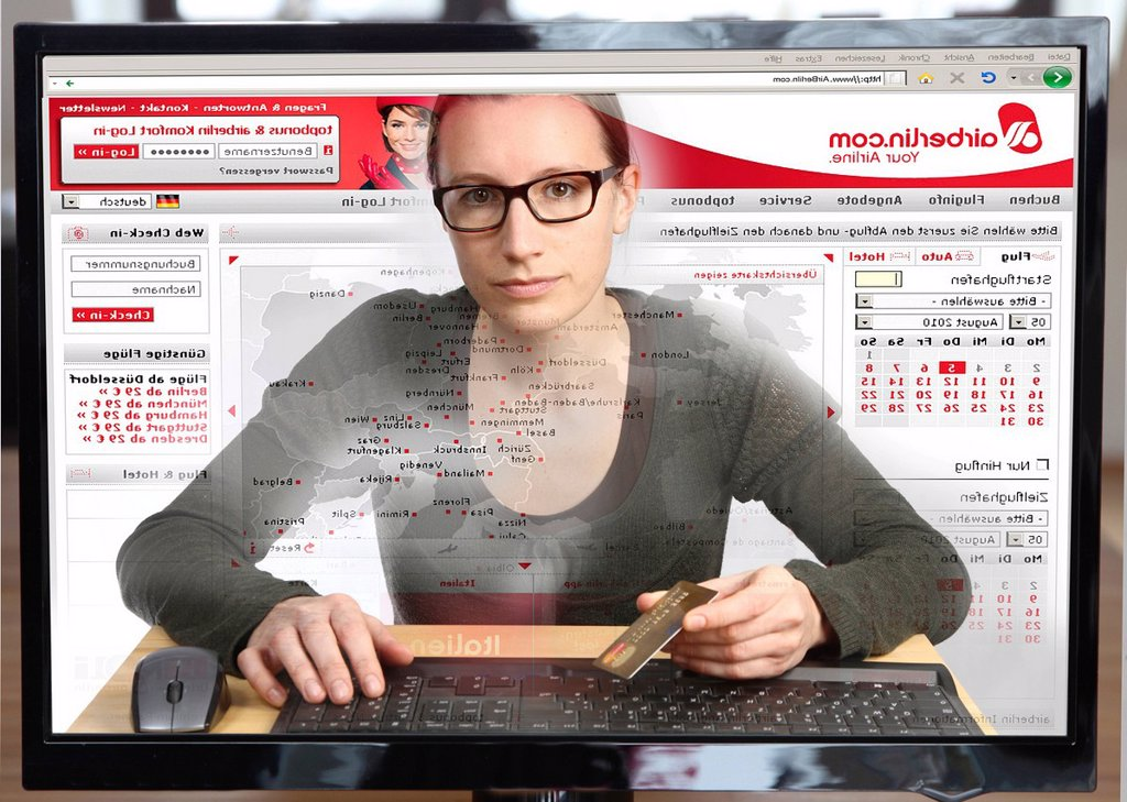 Stock Photo: 1848-608488 Young woman sitting at a computer surfing the Internet, booking a flight on the Airberlin site, view from within the computer, symbolic image