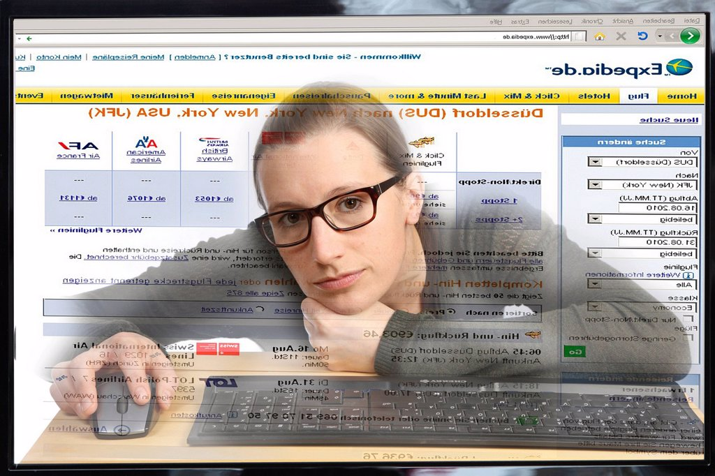 Stock Photo: 1848-608490 Young woman sitting at a computer surfing the Internet, booking a holiday on a travel portal, Expedia, view from within the computer, symbolic image