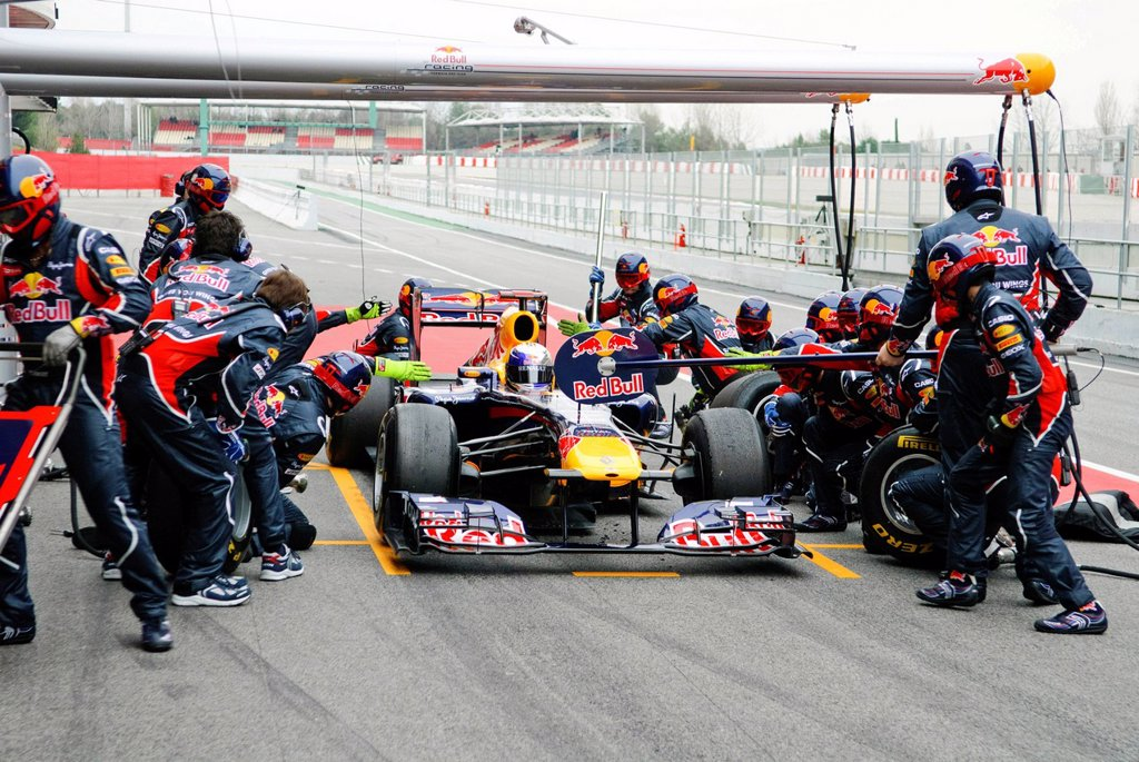 Stock Photo: 1848-608526 Sebastian Vettel, GER, in the Red Bull Racing RB7 Formel 1 racing car, pit stop with pitcrew, Formula 1 testing at the Circuit de Catalunya race track near Barcelona, Spain, Europe