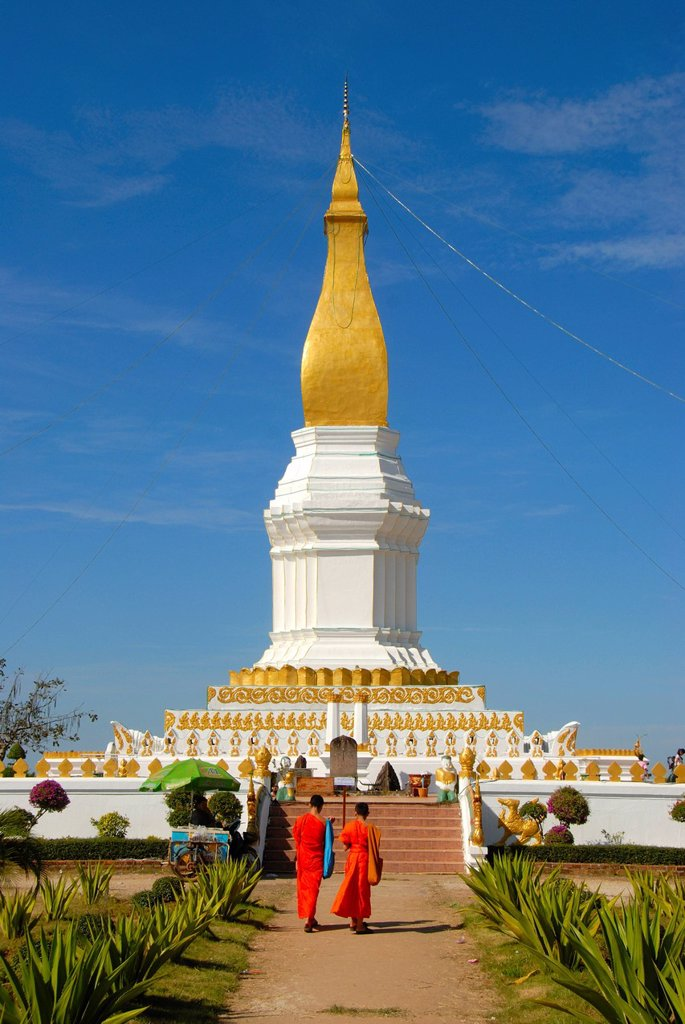 Theravada Buddhism, two monks in orange robes, That Sikhottabong golden stupa, Thakek, Khammuan province, Khammouane, Laos, Southeast Asia, Asia : Stock Photo