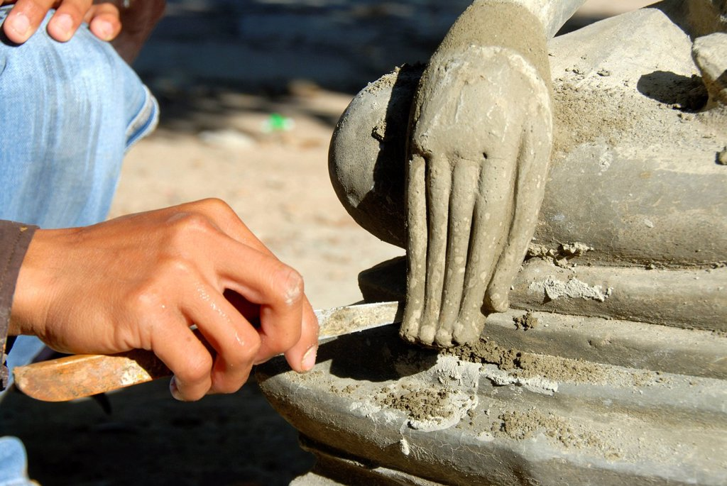 Theravada Buddhism, stonemason, working on a delicate detail, hand of a Buddha statue, Wat Xayaphoum temple, Savannakhet, Laos, Southeast Asia, Asia : Stock Photo