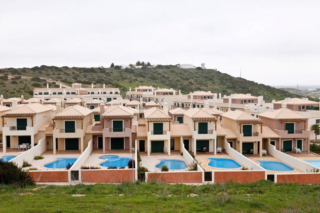 Monotone, uninhabited cottages, town houses with pools, Algarve, Portugal, Europe : Stock Photo