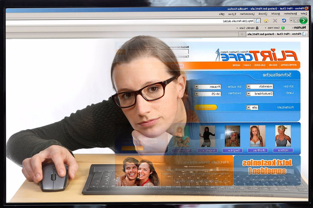 Young woman sitting at a computer surfing the Internet, viewing a page with contact ads, a flirt portal, view from within the computer, symbolic image : Stock Photo