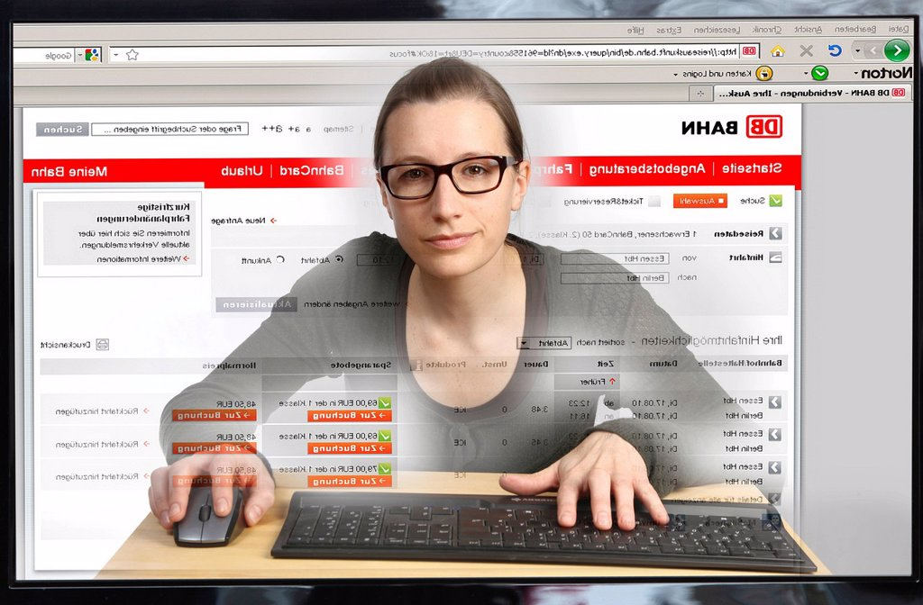Stock Photo: 1848-609105 Young woman sitting at a computer surfing the Internet, booking a train trip on the Internet portal of Deutsche Bahn, view from within the computer, symbolic image