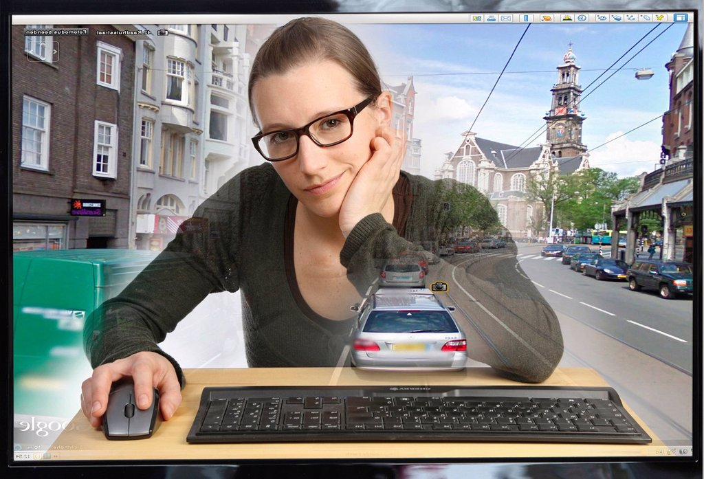 Stock Photo: 1848-609111 Young woman sitting at a computer using Google Street View, image detail with a section of the city of Amsterdam, people and license plate numbers have been censored, view from within the computer, symbolic image