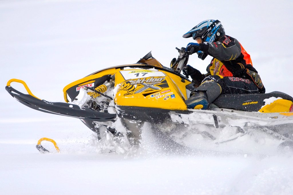 Skidoo snowmobile in action : Stock Photo