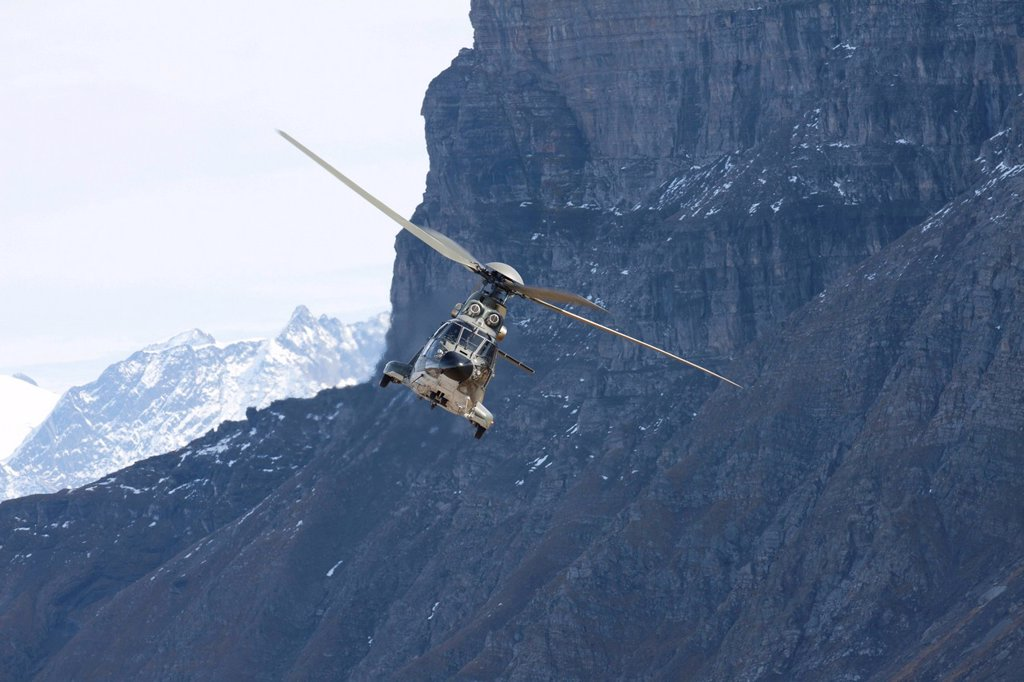 Stock Photo: 1848-609753 The Swiss military helicopter Cougar in front of a rock wall, mountain_air show of the Swiss Air Force at Axalp, Ebenfluh, Interlaken, Bern, Switzerland, Europe