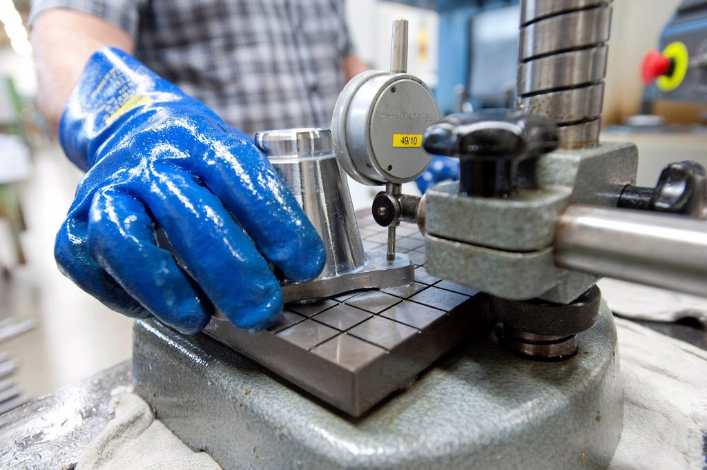 Stock Photo: 1848-609761 Quality control, measuring with a ruler, machining steel turned parts, GETRAG transmission and drivetrain systems, Hermann Hagenmeyer GmbH & Cie KG, Bad Windsheim factory, Bavaria, Germany, Europe