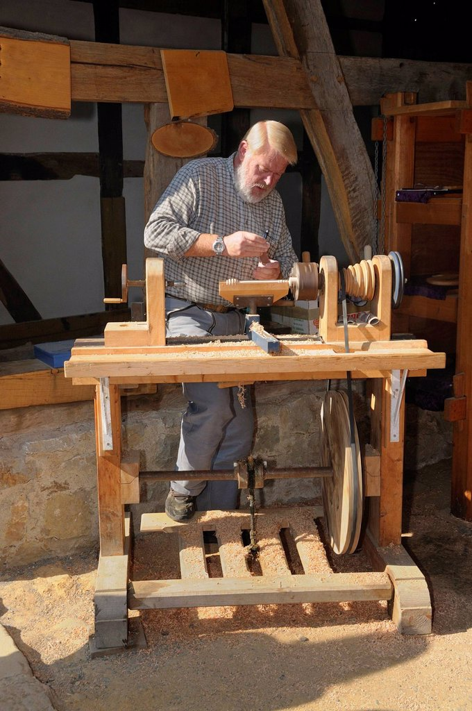 Stock Photo: 1848-610338 Turner working on a foot powered lathe, Hessenpark outdoor museum near Neu_Anspach, Hochtaunuskreis district, Hesse, Germany, Europe