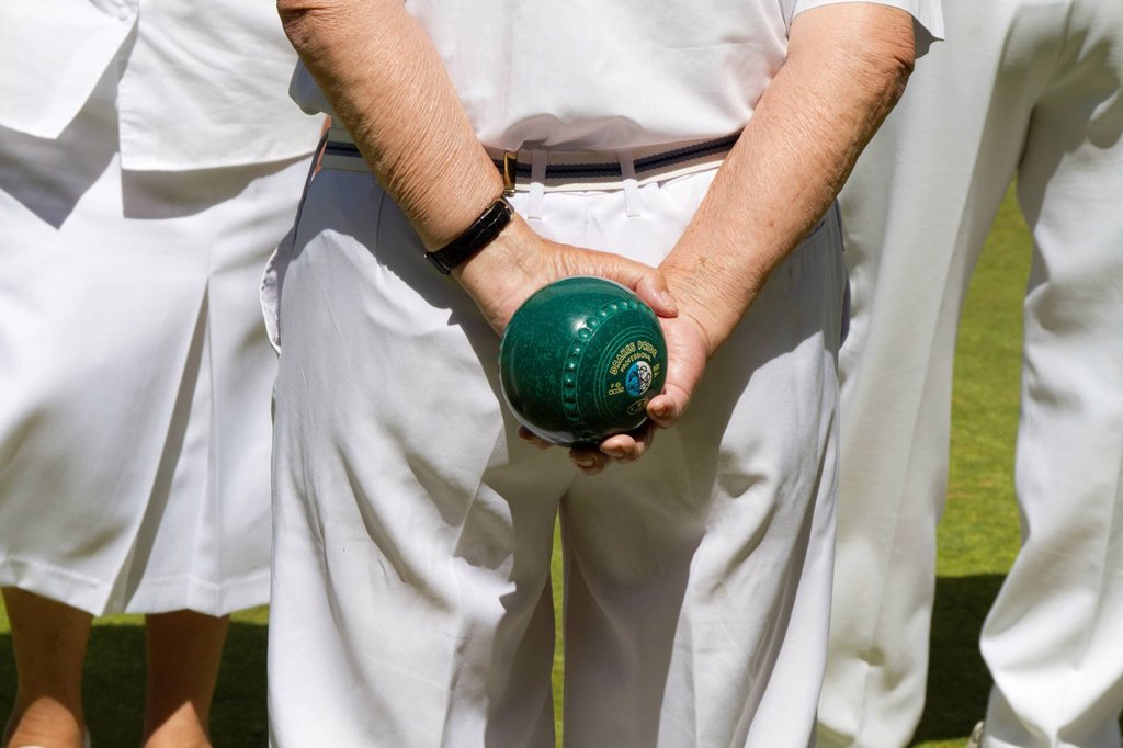 Stock Photo: 1848-610603 Man holding a bowling ball, Helston Bowling Club, Helston, Cornwall, England, United Kingdom, Europe
