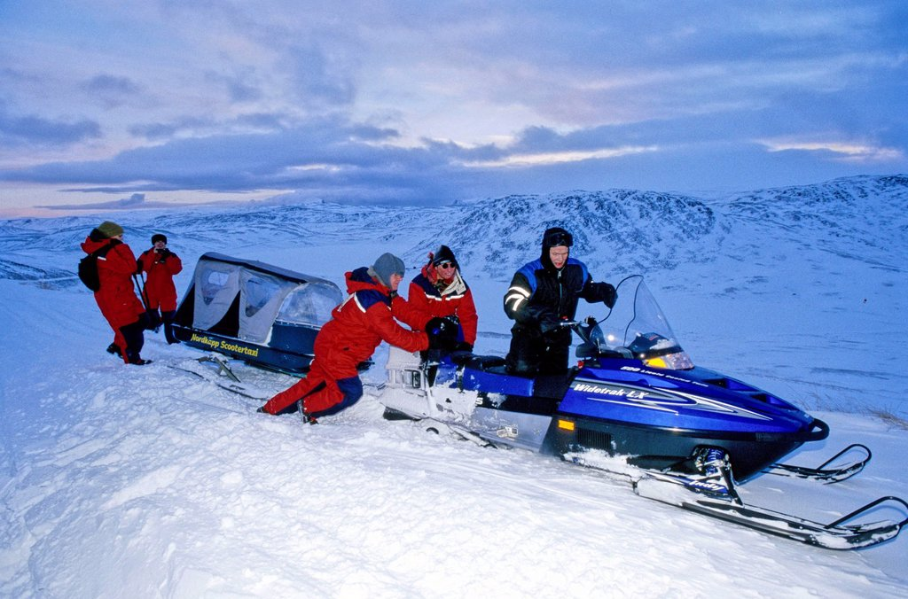 A snowmobile has stalled at the North Cape and is set afloat again, Norway, Europe : Stock Photo