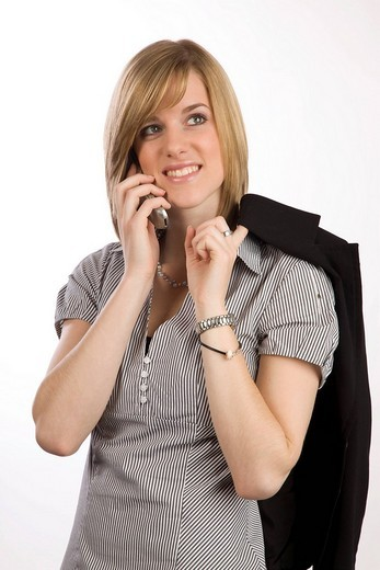 Young blond woman using a cellphone : Stock Photo