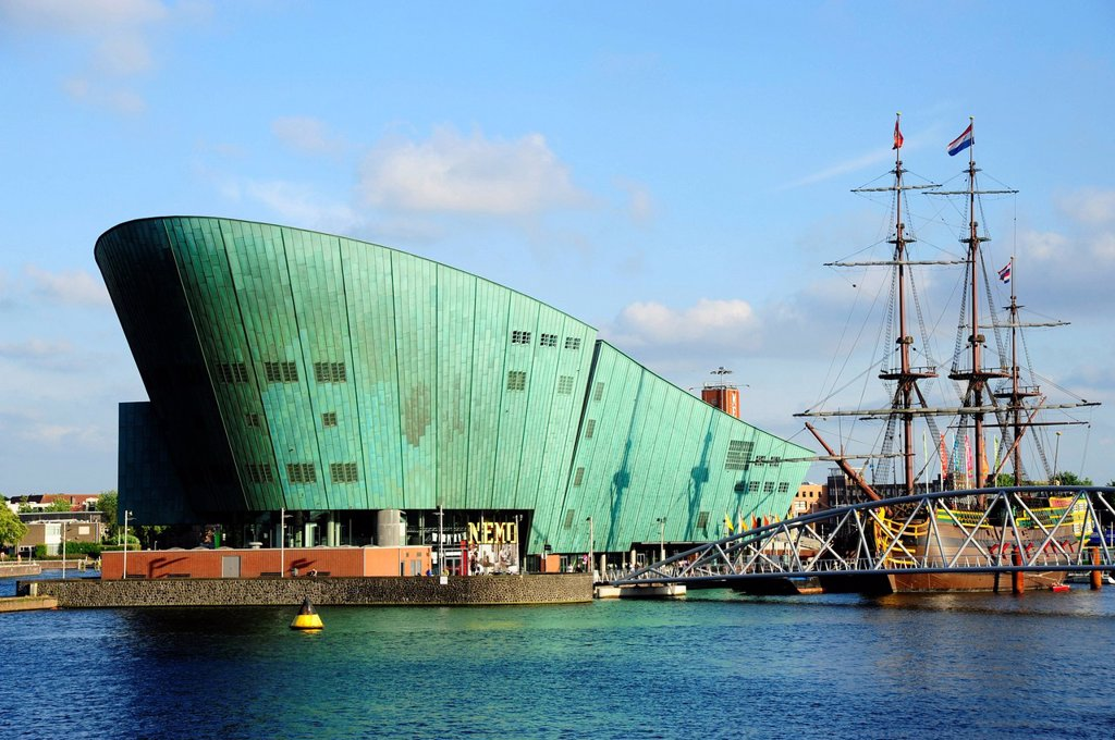 NEMO Science and Technology Center on Oosterdok wharf, replica of a sailing ship of the maritime museum, Scheepvaart Museum, Amsterdam, North Holland, Noord_Holland, the Netherlands, Europe : Stock Photo