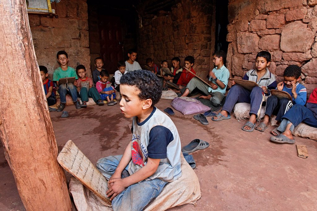 Stock Photo: 1848-611622 Boys of the village of Iwasoudane attending a Koran school, learning and reciting Koran verses which are written on wooden boards, Ait Inzel Gebel Region, Atlas Mountains, Morocco, Africa