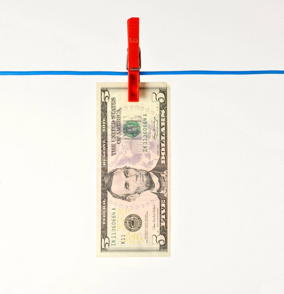 Stock Photo: 1848-611658 U.S. dollar bank note on a clothesline, symbolic image for money laundering, dirty money