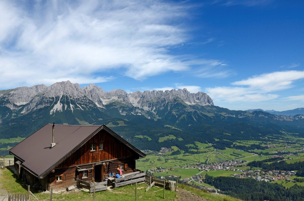 Hikers at Lederer Alm mountain hut, Mt Hartkaiser, views of Wilder Kaiser massif, Tyrol, Austria, Europe : Stock Photo