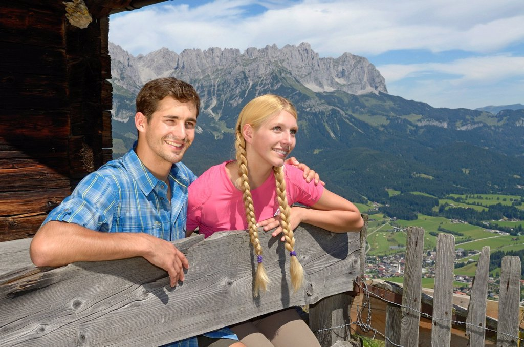 Stock Photo: 1848-612133 Hikers resting at Lederer Alm mountain hut, Mt Hartkaiser, views of Wilder Kaiser massif, Tyrol, Austria, Europe