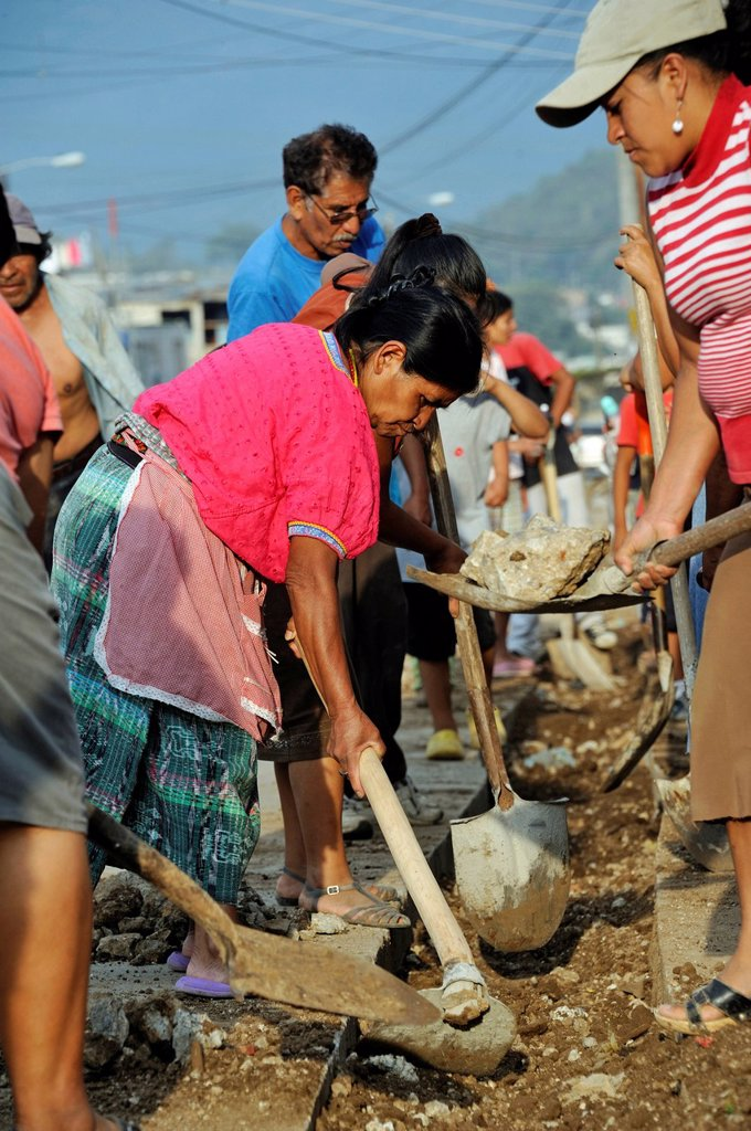 Women working together to improve the sewer system of their neighborhood, Lomas de Santa Faz slum, Guatemala City, Guatemala, Central America : Stock Photo
