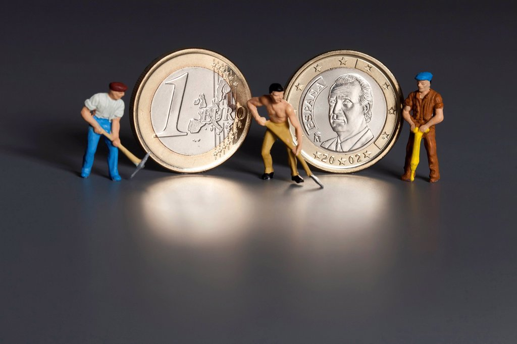 Spanish 1 euro coins with miniature worker figures, symbolic image for the labor market, one_euro jobs, debt, wages, pensions : Stock Photo