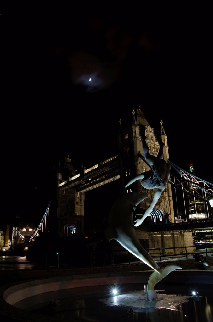 Illuminated Tower Bridge with the sculpture Girl with a Dolphin by David Wynne, at night, River Thames, London, England, United Kingdom, Europe : Stock Photo