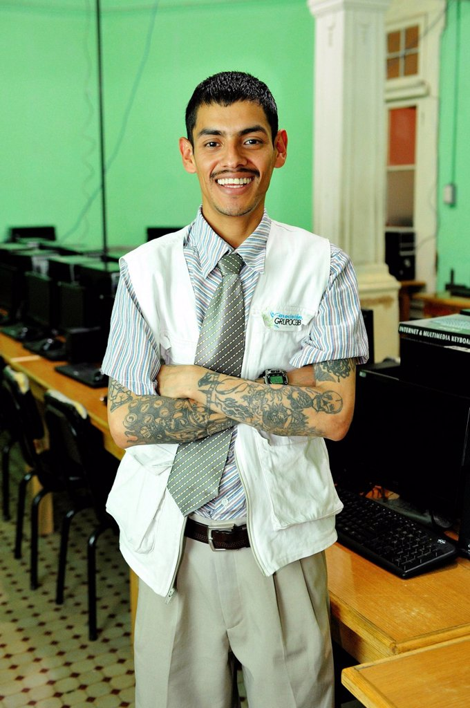 Computer science teacher, 29 years old, a former hired killer and member of a gang of youths, each of his 72 murders was honored with a tattoo, vocational school of the human rights organization El Ceiba, Guatemala City, Guatemala, Central America : Stock Photo