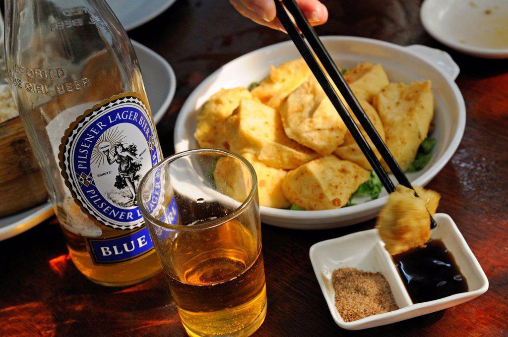 Blue Girl beer with fish at the restaurant of the Tai O Fishing Village, Lantau Island, Hong Kong, China, Asia : Stock Photo