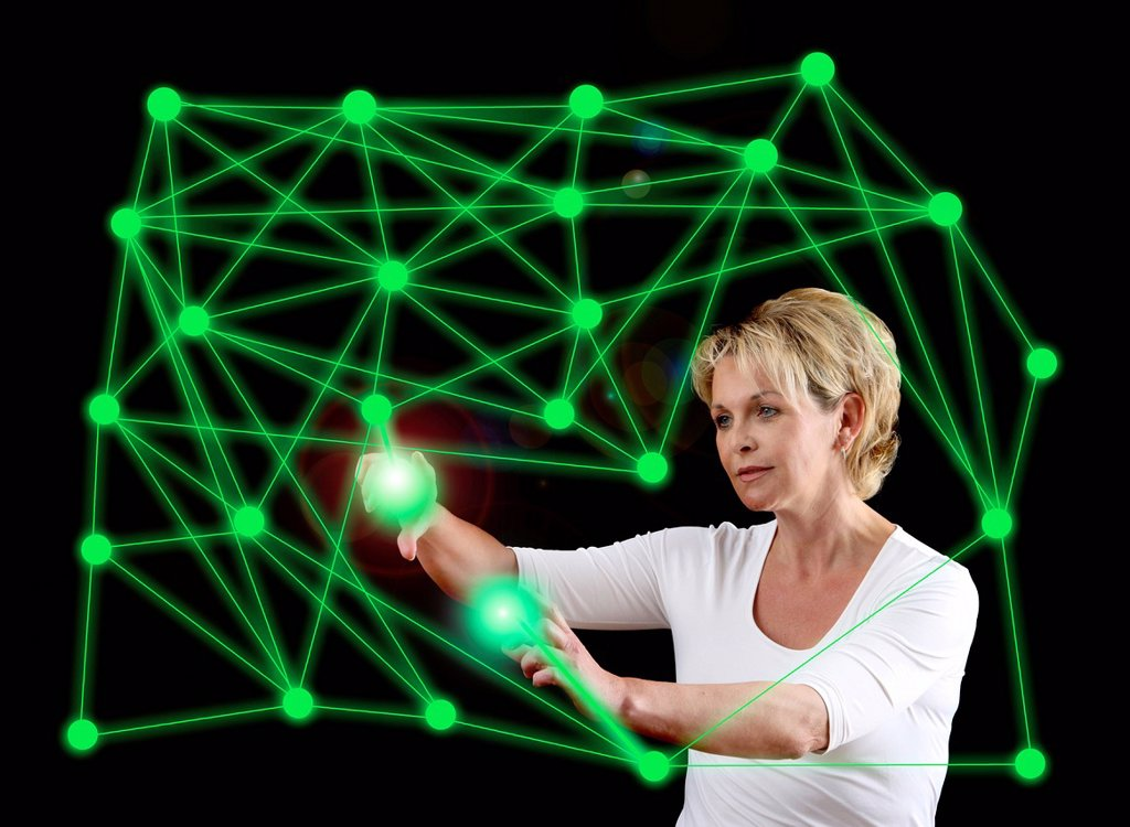 Woman with a virtual model, symbolic image for networks, networking : Stock Photo