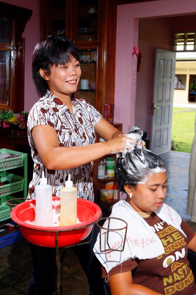 Stock Photo: 1848-614237 Young woman washing hair during a hairdressing apprenticeship, vocational training center, Siantar, Sumatra, Indonesia, Asia