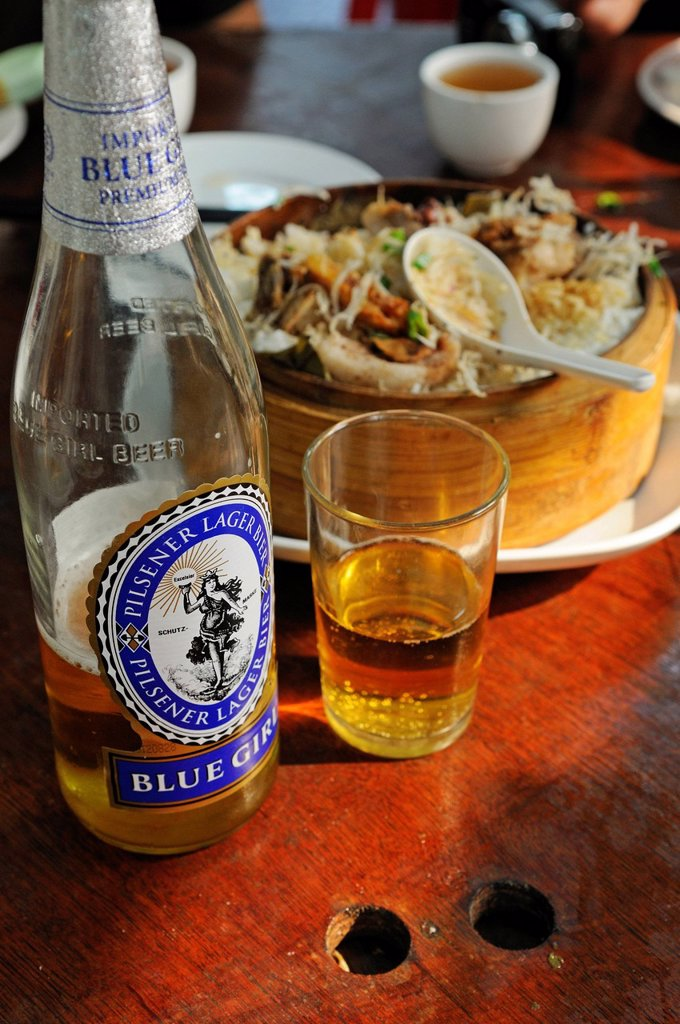 Blue Girl beer with fish at the restaurant of the Tai O Fishing Village, Lantau Island, Hong Kong, China, Asia : Stock Photo