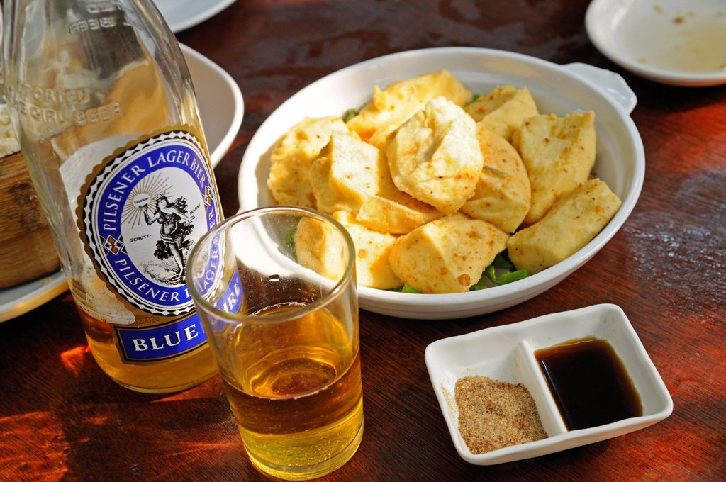 Stock Photo: 1848-614594 Blue Girl beer with fish at the restaurant of the Tai O Fishing Village, Lantau Island, Hong Kong, China, Asia