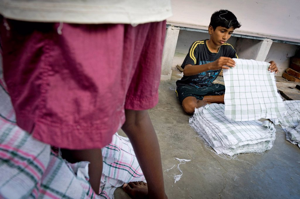 Boy, 13 years, working in a towel production, child labourer, Karur, Tamil Nadu, South India, India, Asia : Stock Photo