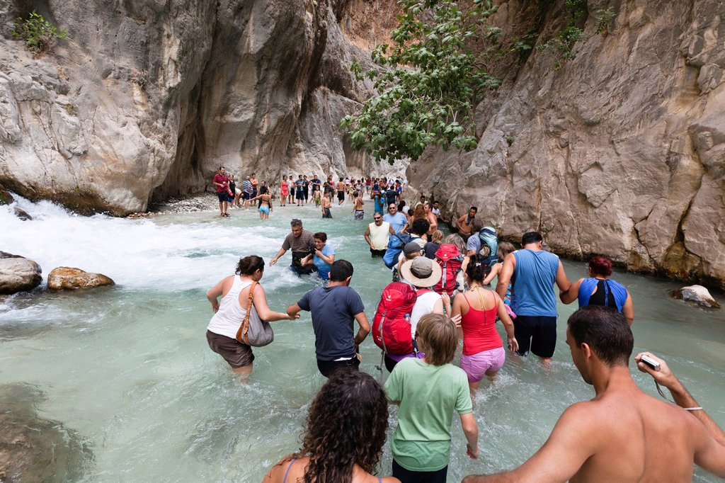 Stock Photo: 1848-616751 Tourists walking in the water of the gorge, Saklikent Gorge near Tlos and Fethiye, Lycian coast, Lycia, Mediterranean, Turkey, Asia Minor