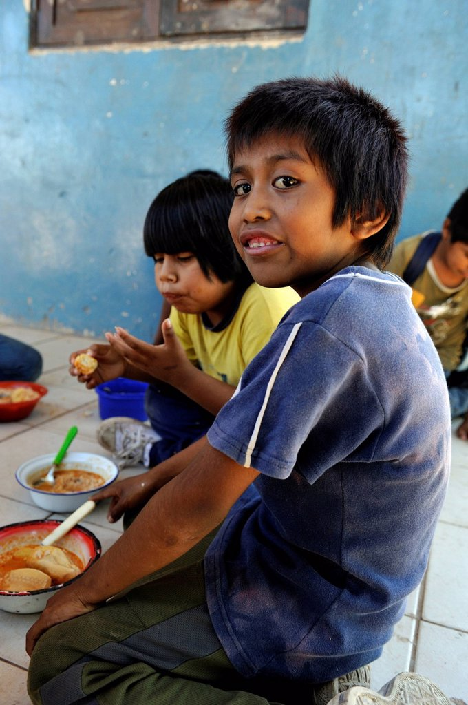 Stock Photo: 1848-617573 Boys eating lunch that was provided at the village school, village of the indigenous Wichi people, Comunidad Tres Pocos, Formosa province, Argentina, South America