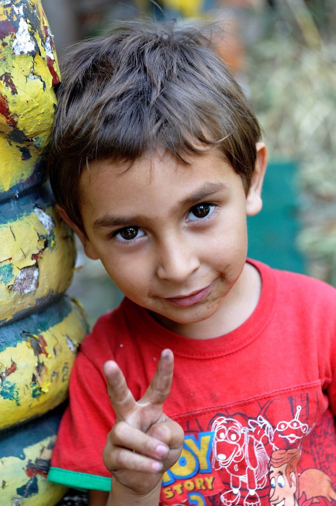 Little boy making the victory sign, Buenos Aires, Argentina, South America : Stock Photo