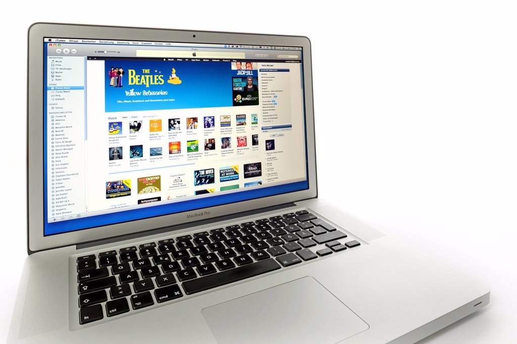 Stock Photo: 1848-617882 Apple iTunes Store, website displayed on the screen of an Apple MacBook Pro