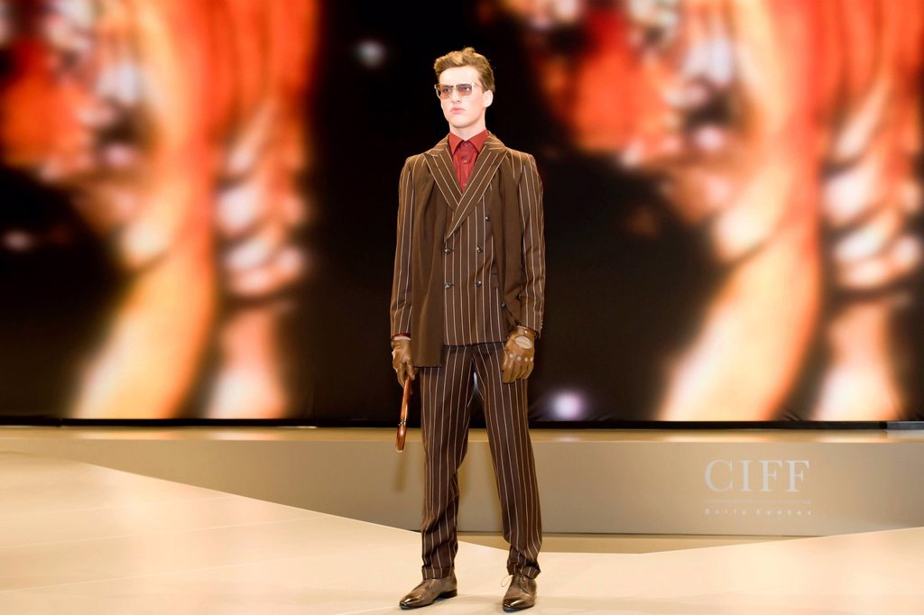 Stock Photo: 1848-618018 Young man presenting modern striped suit, Copenhagen International Fashion Fair, Copenhagen, Denmark, Europe