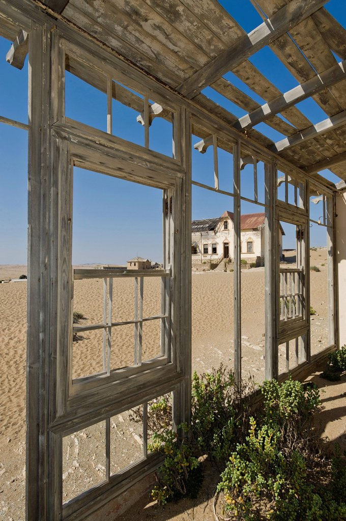 View from the porch of a ruined house, abandoned diamond mine, Kolmanskop, Namibia, Africa : Stock Photo