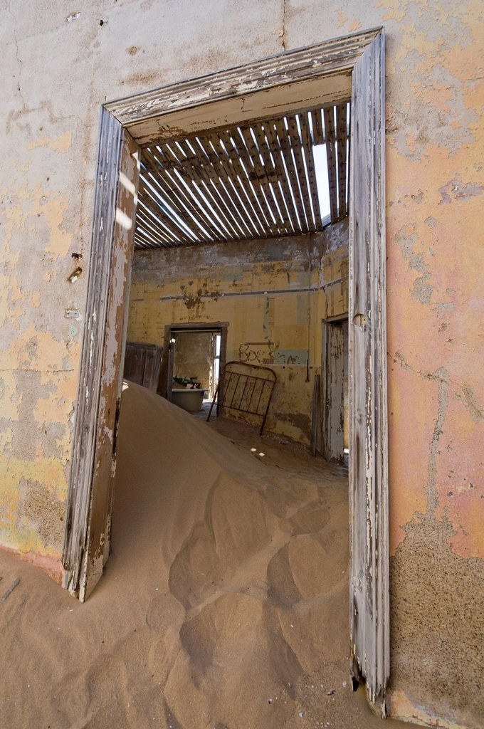 Stock Photo: 1848-618185 Desert sand and a door in a ruined house, abandoned diamond mine, Kolmanskop, Namibia, Africa