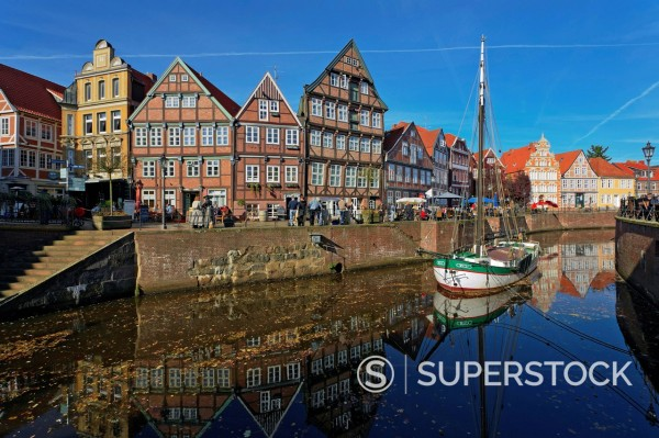 Willie lighter in the old harbour, historic half_timbered houses at Wasser West quayside at back, Stade, Lower Saxony, Germany, Europe, PublicGround : Stock Photo