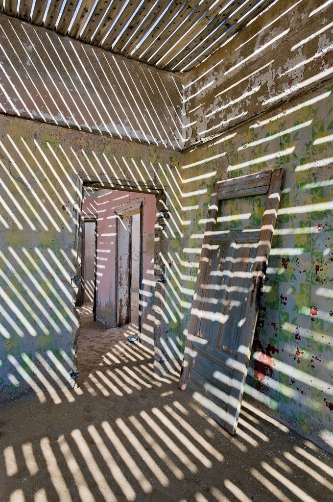 Stock Photo: 1848-618869 Shadows and a door in a ruined house, abandoned diamond mine, Kolmanskop, Namibia, Africa