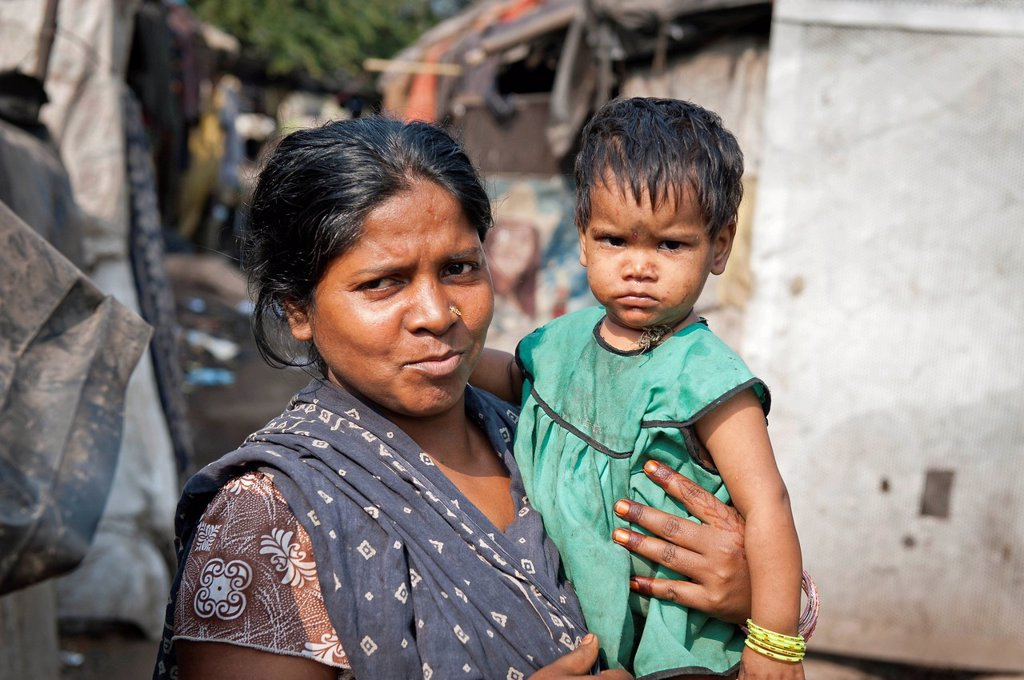 Stock Photo: 1848-619050 Woman with a toddler in her arms, slum, Shibpur district, Haora or Howrah, Kolkata or Calcutta, West Bengal, East India, India, Asia