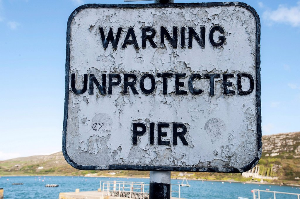 Warning sign, warning unprotected pier, Crookhaven, County Cork, Republic of Ireland, Europe : Stock Photo
