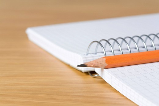 Stock Photo: 1848-62093 Pencil placed on top of a spiral notebook