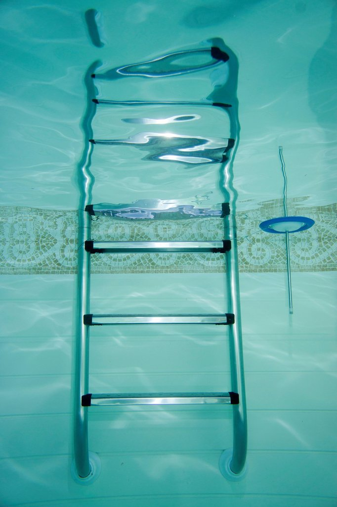 Swimming pool ladder with a thermometer, Germany, Europe : Stock Photo