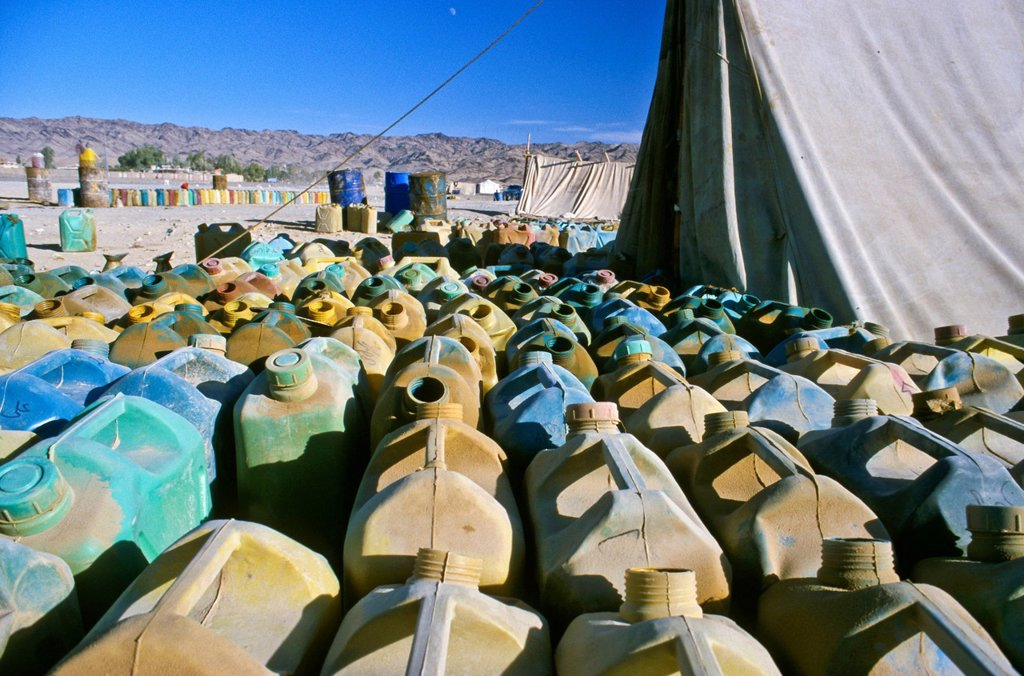 Stock Photo: 1848-621190 Petrol station selling smuggled petrol from Iran to truck drivers in Pakistan, Noshki, Belouchistan, Pakistan, Asia