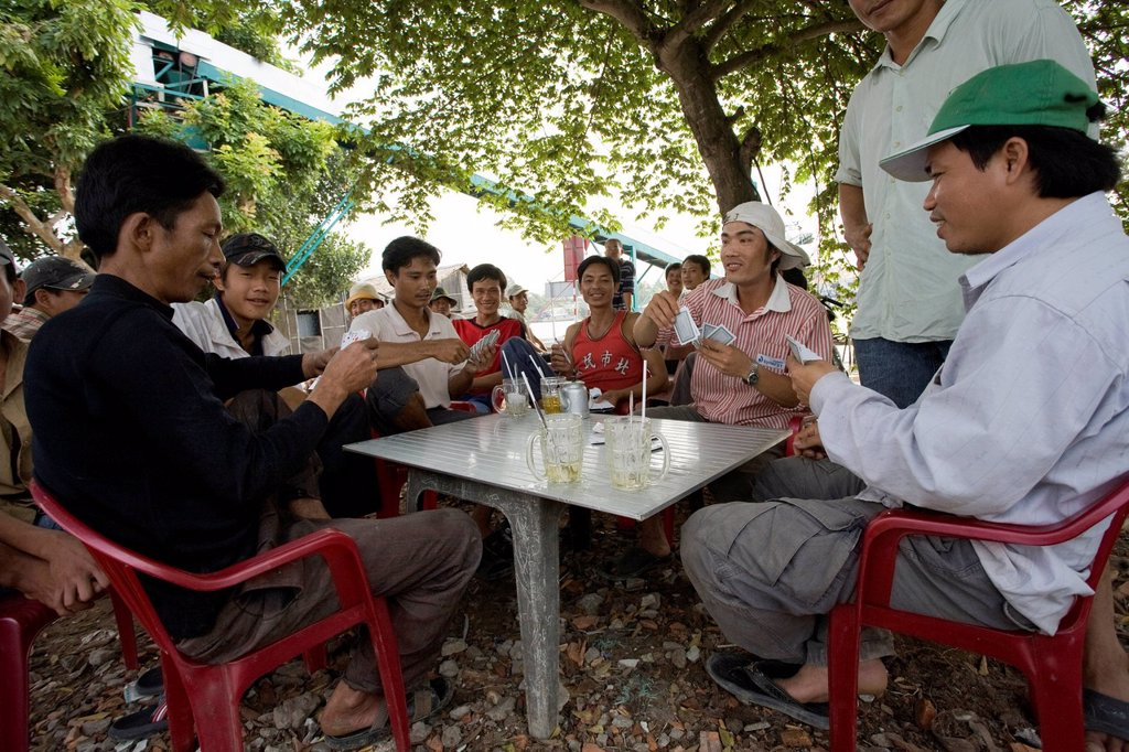 Men playing cards in Can Tho, Mekong Delta, South Vietnam, Vietnam, Southeast Asia, Asia : Stock Photo