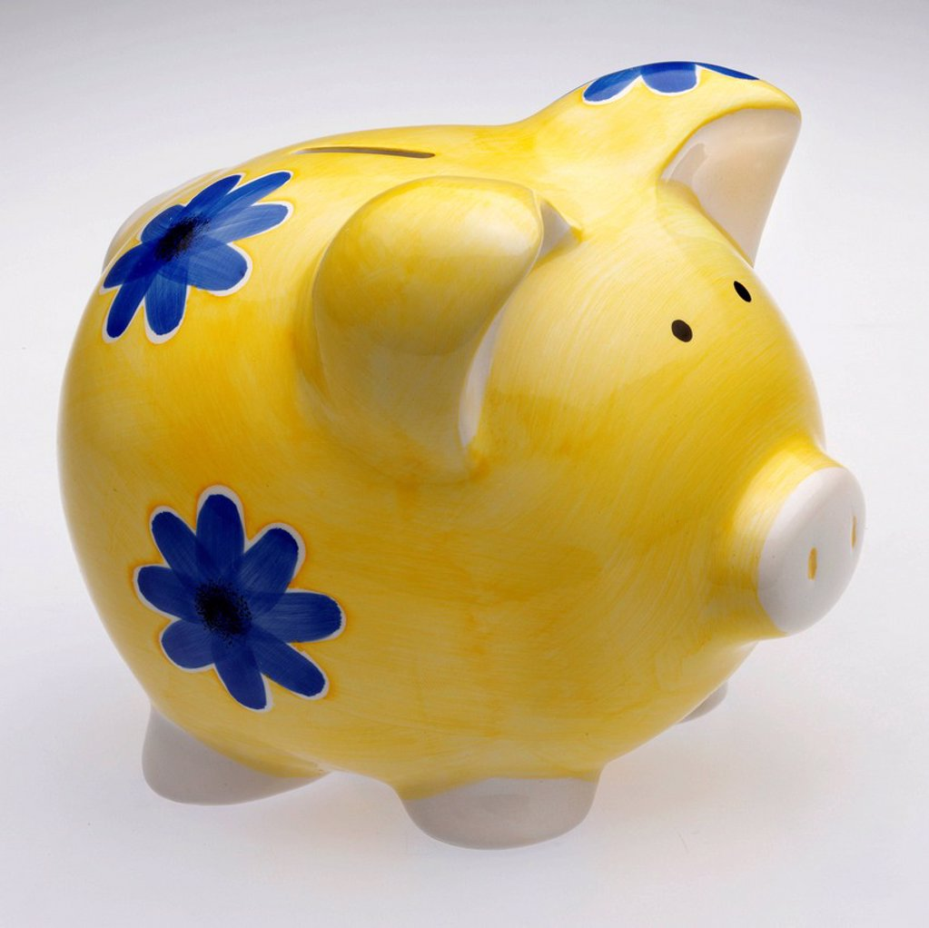 Stock Photo: 1848-622068 Yellow piggy bank with blue flowers